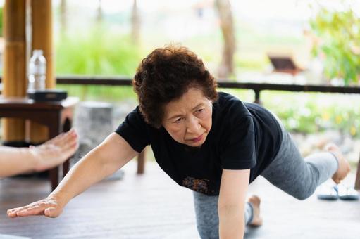 Senior woman doing gymnastics