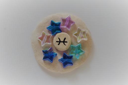 Stars surrounding the Pisces mark (spiritual)