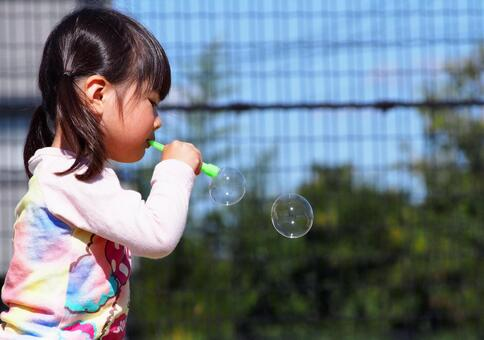 Girls playing with soap bubbles