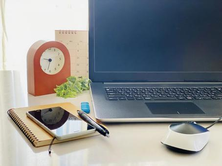 Left side of laptop, clock, calendar, smartphone and writing utensils_death