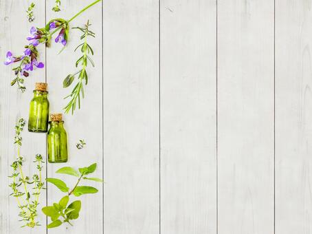 White grain background of herbs and essential oils