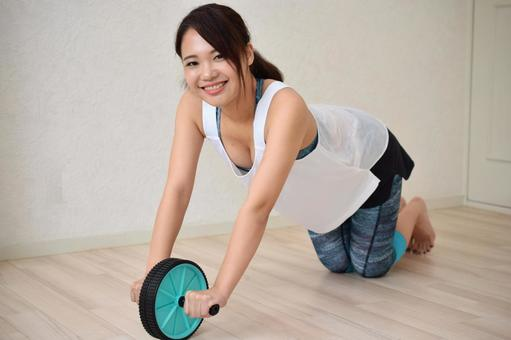 Woman doing abs roller