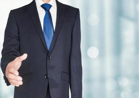The front of a businessman in a handshake pose