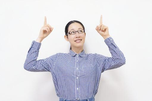 Woman pointing to business point