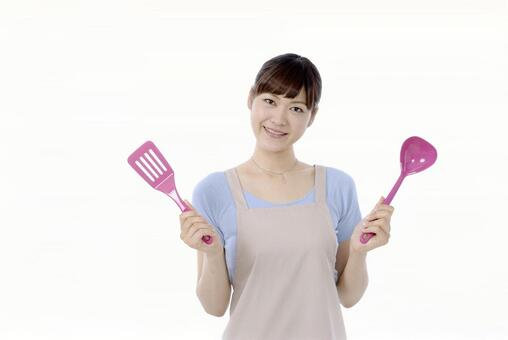 Woman with kitchen tool 1