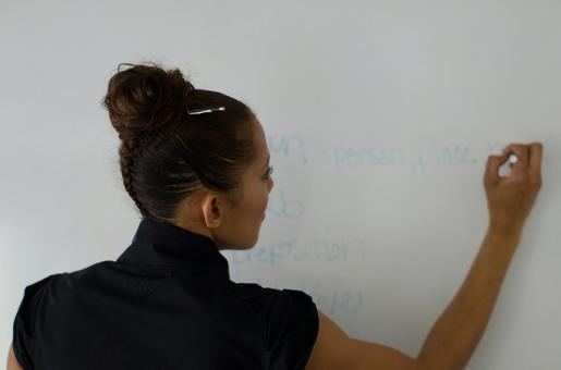 Business woman writing a woman 16