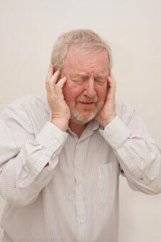 A man who plugs an ear