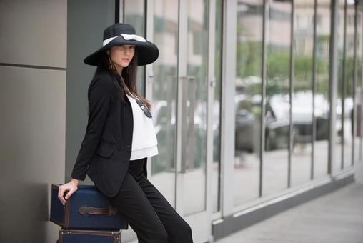 Woman sitting in luggage 6
