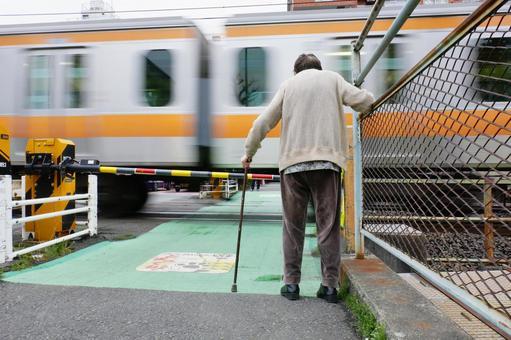 Elderly people and railroad crossing