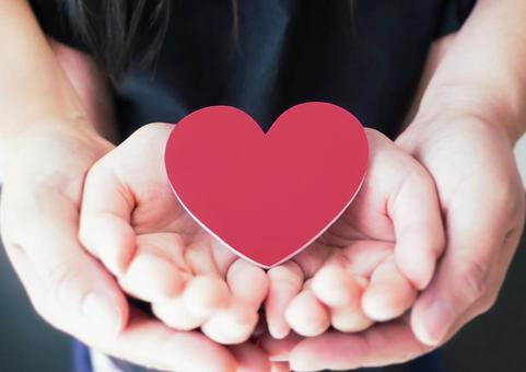 Heart supported by parent and child