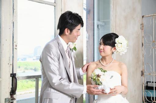 Bride and bridegroom staring together 3