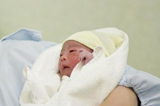 Baby embraced in obstetrics and gynecology