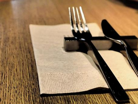 Knife and fork on the table