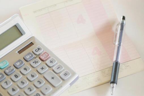 Passbook, calculator and ballpoint pen
