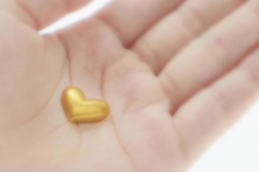 A small heart in the palm