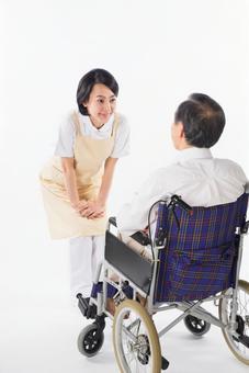 A nurse and a wheelchair male 13