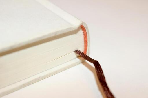 A string attached to a book