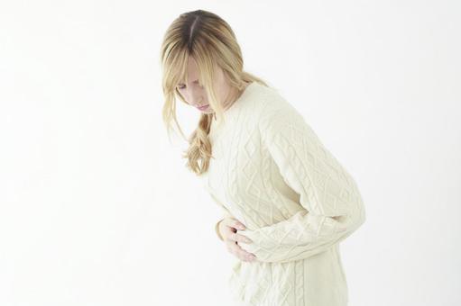 Woman holding abdomen 3