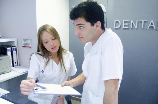 Reception staff and doctor