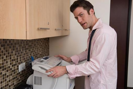 Office employee using office fax 1