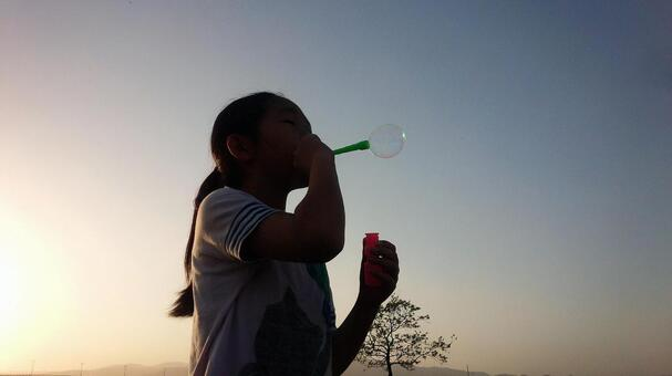 A girl playing soap bubbles