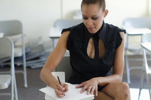 Women taking business notes 4
