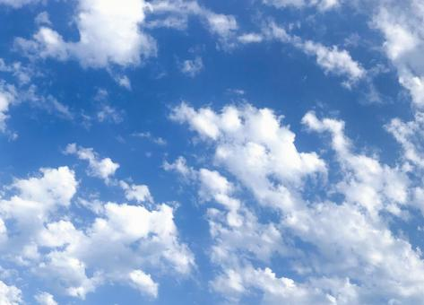 Cotton-like clouds and sky