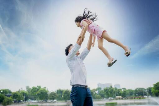 Asian dad 2 holding a daughter