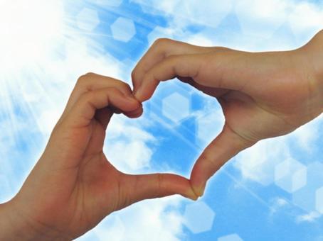 Sky and heart hand