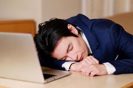Hotel man lying down on the desk