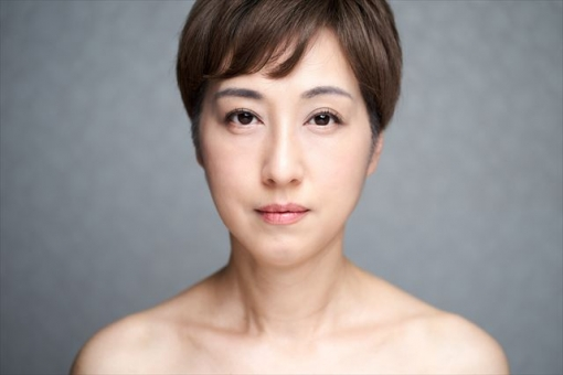 A middle-aged Japanese woman staring straight at the camera