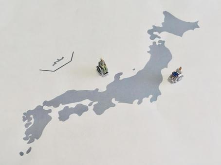 Elderly people in wheelchairs and a map of Japan