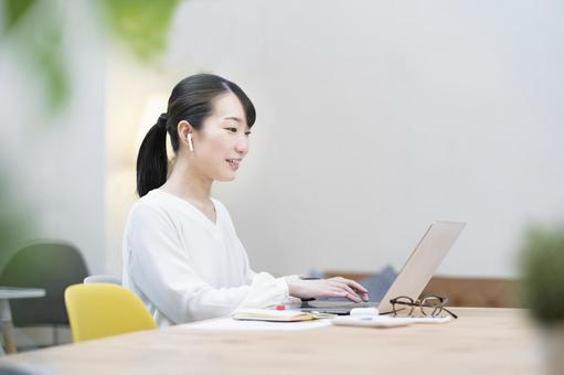 A woman working in a casual space