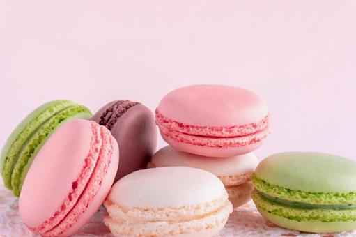 Pink background of lots of macaroons