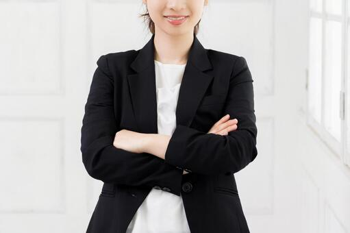 Young business woman with arms folded