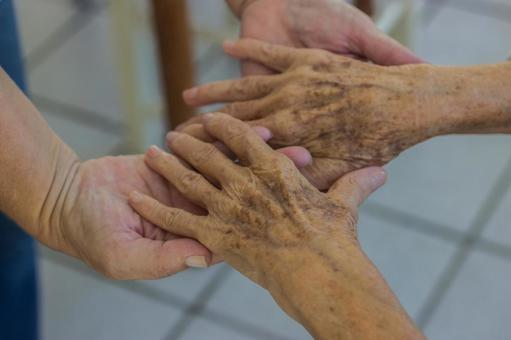 Elderly hands and supporting hands 11