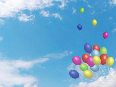 Balloons fly in the sky