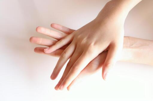A woman's beautiful hands overlapping