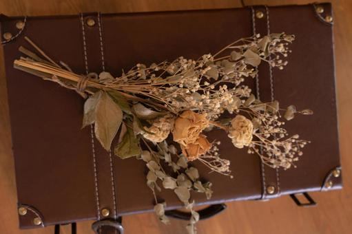 Dried flowers on antique bag