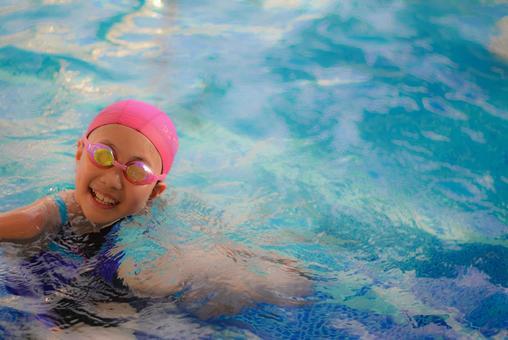 Swimmer wearing a pink cap