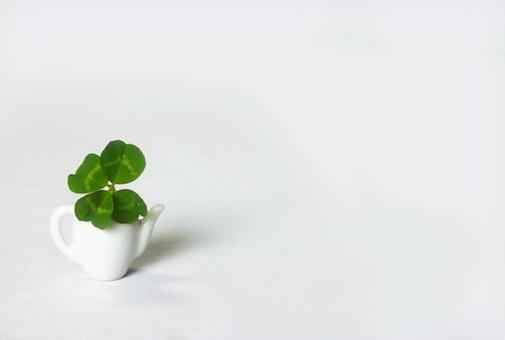 Four leaf clover and pot Four-Leaf Clover and Tea Pot