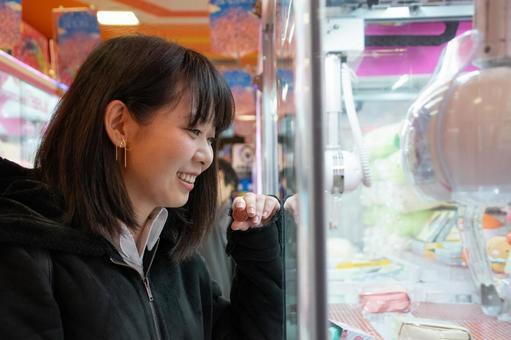 Woman enjoying crane game