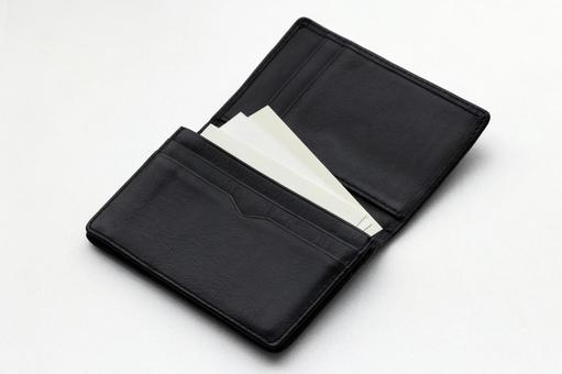 Black business card holder and white background