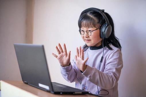 Girls taking online lessons