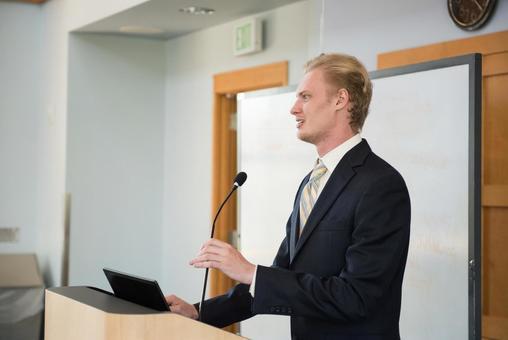 White male speaking 8