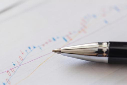 Stock chart and ballpoint pen