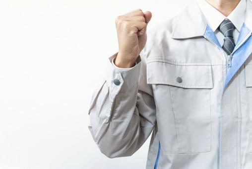 Worker guts pose businessman