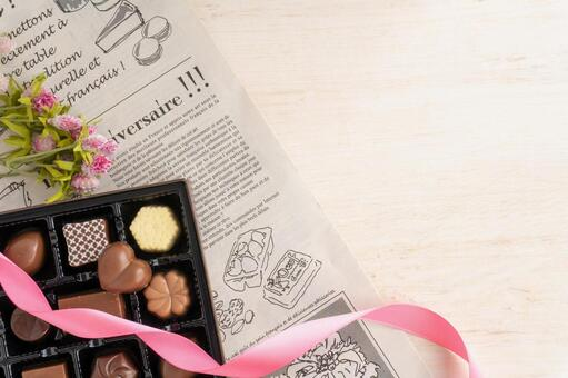 Assorted chocolates, flowers and ribbons