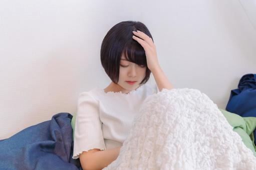 A woman who can't sleep because of a headache