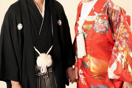 Bride and groom kimono holding hands